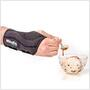 The Mueller Green Fitted Wrist Brace allows for use of the thumb