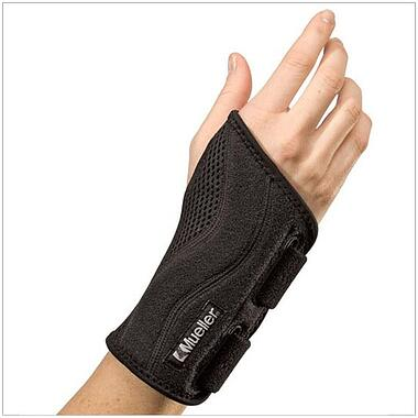 The Mueller Green Fitted Wrist Brace comfortably cushions and supports weak or injured wrists